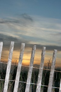 Sunset and fence on Bald Head Island, N.C.