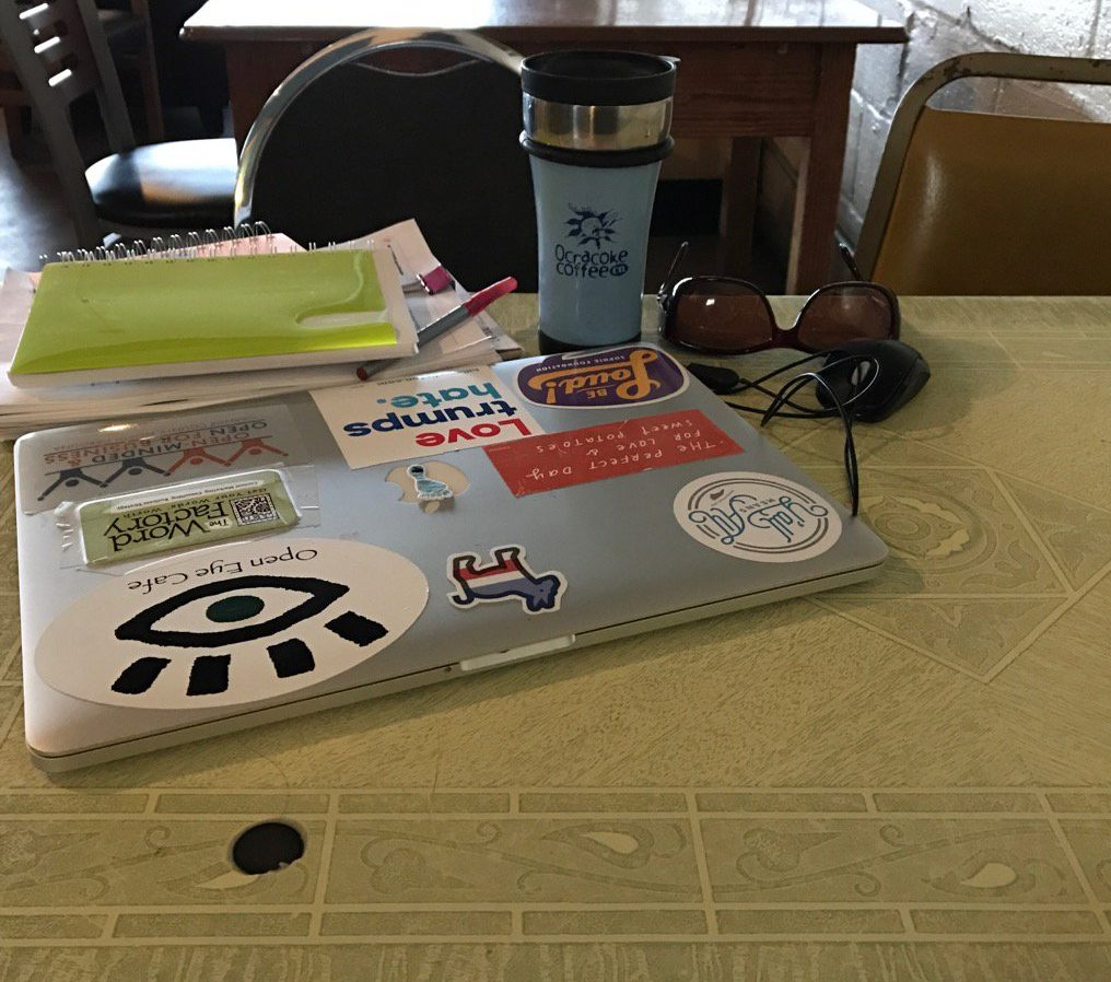 A photo of The Word Factory's official table at The Open Eye Cafe