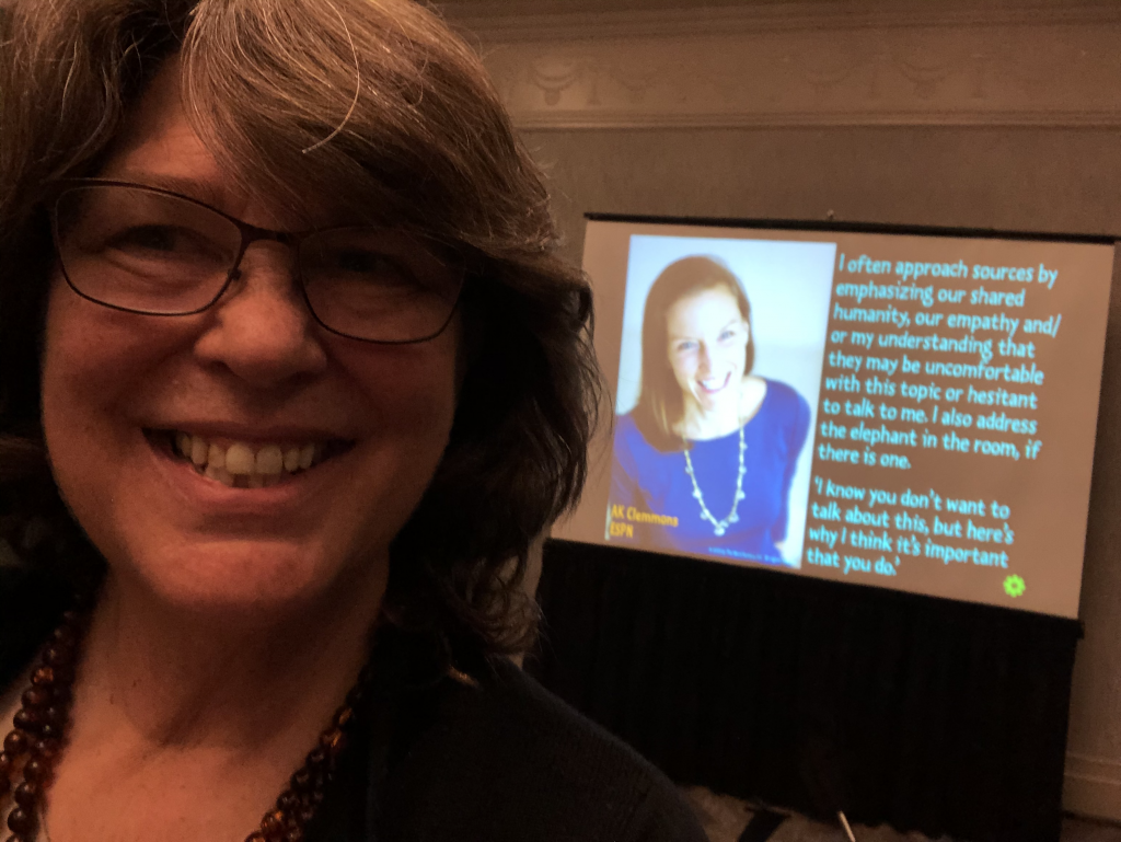 Margot Lester speaking at the National High School Journalism Convention in Washington, DC, with journalist AK Clemmons in the background. November 2019.